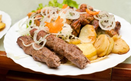 mutton chops: eastern cuisine - long minced mutton chops with fried potatoes and meat