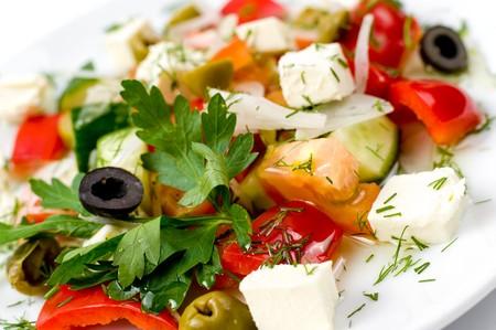 greek salad on white plate, macro photo