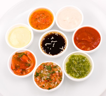 chili sauce: eastern cuisine - several sauceboats with different sauces and seasonings Stock Photo