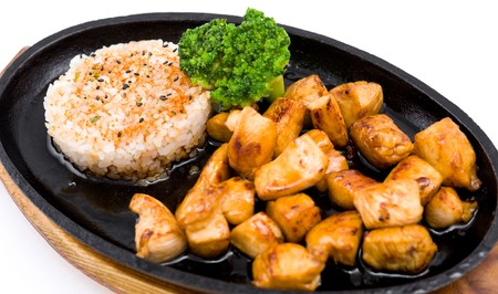big pieces of grilled chicken, garnished with rice photo