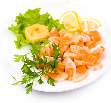 cut salmon served with lemon and mustard photo