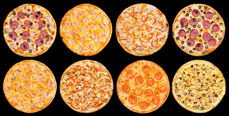 eight different pizzas in one set, isolated on black, top view photo