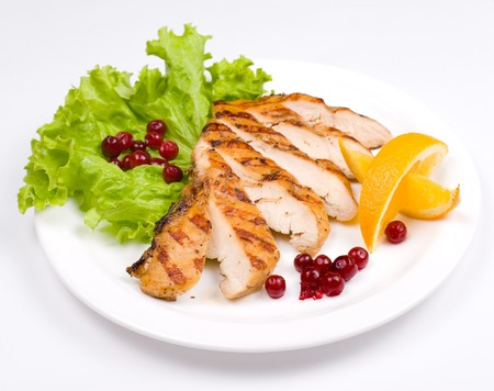 grilled chicken breast, served with cranberries and oranges photo