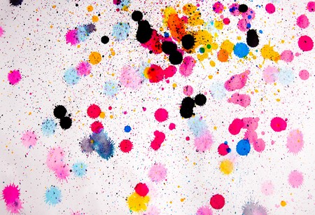 splashed: paint blots of different colours splashed on paper
