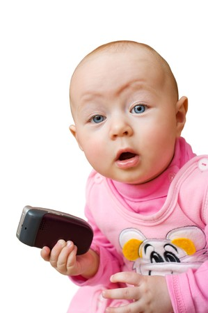 little european surprised baby girl holds cell phone, isolated photo