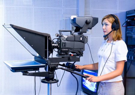 a female cameraman at a studio during live broadcasting photo
