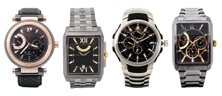 costly: a set of four different mens watches over white Stock Photo