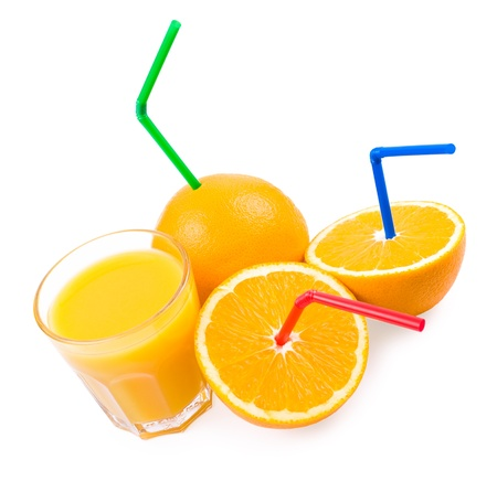 oranges with straws and a glass with orange juice Stock Photo
