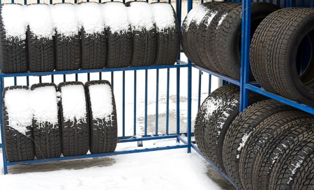 automobile winter tyres on sale, covered with snow photo