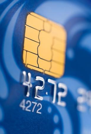 plastic money: a blue bank card, macro, narrow focus Stock Photo
