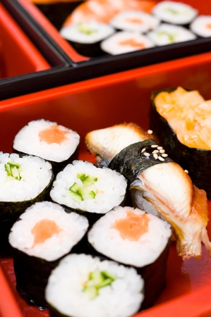 sectioned: sushi rolls on a traditional oriental sectioned dish