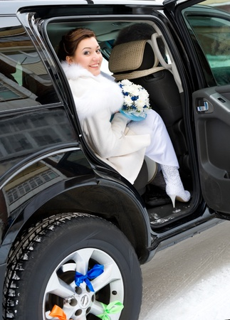 young happy bride looks out of car Stock Photo - 8403723