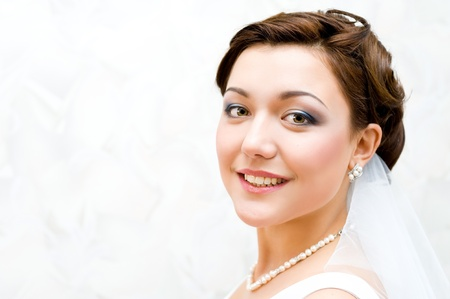 young charming bride looks into camera, closeup Stock Photo - 8519464