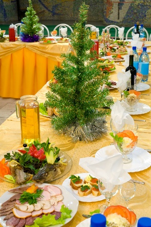 laid banquet restaurant table at New Years party photo