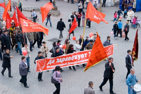 communists: ULAN-UDE, RUSSIA - MAY 1: Communists demonstration moves along city streets with banners and red flags on annual Labour Day, May, 1, 2009 in Ulan-Ude, Buryatia, Russia.
