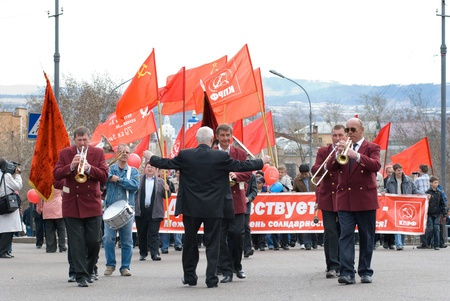 communists: ULAN-UDE, RUSSIA - MAY 1: Communists demonstrate along Lenin Street with an orchestra ahead on annual Labour Day, May, 1, 2009 in Ulan-Ude, Buryatia, Russia.