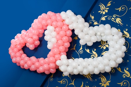 convivial: two hearts of balloons - pink and white -  decoration of wedding banquet room