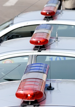 flashers: ULAN-UDE, RUSSIA - MAY 9: A line of flashers on cars of road police convoy on annual Victory Day, May, 9, 2009 in Ulan-Ude, Buryatia, Russia. Editorial