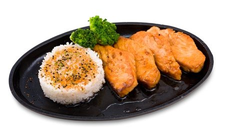 big pieces of grilled salmon, garnished with rice photo
