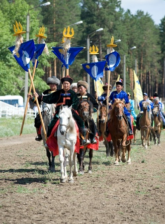 naadan: ULAN-UDE, RUSSIA - JULY 17: The 4th General Session of the World Mongolians Convention, July 17, 2010 in Ulan-Ude, Buryatia, Russia. Riders carry the Convention standards.