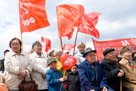 ULAN-UDE, RUSSIA - MAY 1: Communists gathered at Revolution Square on annual Labour Day, May, 1, 2009 in Ulan-Ude, Buryatia, Russia. Stock Photo - 8652873