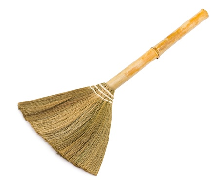 broom handle: a broom with a bamboo handle, over white Foto de archivo