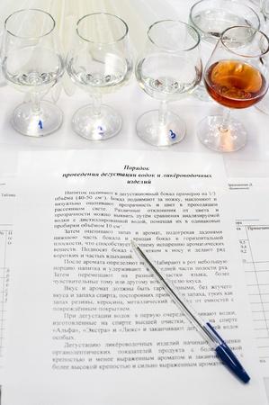 sampling: wine sampling - a line of numbered goblets and a memo for tasters