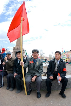 ULAN-UDE, RUSSIA - MAY 1: Communists gathered at Revolution Square on annual Labour Day, May, 1, 2009 in Ulan-Ude, Buryatia, Russia. Stock Photo - 8722893