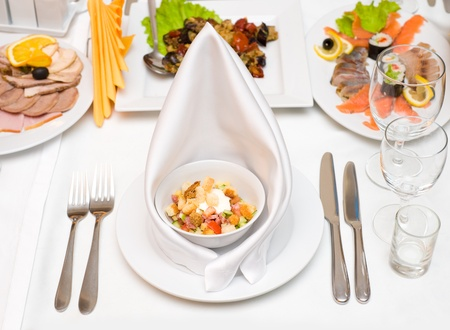 a place setting at laid restaurant banquet table photo