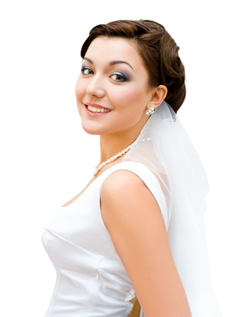 young charming bride looks into camera, isolated photo