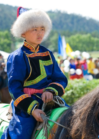 ULAN-UDE, RUSSIA - JULY 17: The 4th General Session of the World Mongolians Convention, July 17, 2010 in Ulan-Ude, Buryatia, Russia. A boy jockey waits for a horse race. Stock Photo - 8779883