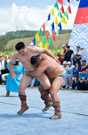 naadan: ULAN-UDE, RUSSIA - JULY 17: The 4th General Session of the World Mongolians Convention, July 17, 2010 in Ulan-Ude, Buryatia, Russia. Mongolian national wrestling in lightweight.