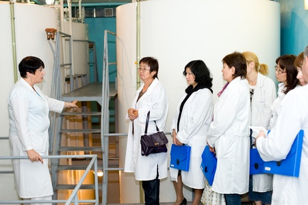 introduces: ULAN-UDE, RUSSIA - AUGUST 18: The main technologist of Baikalfarm, the biggest regional distillery, introduces manufacturing process to journalists, August 18, 2010, Ulan-Ude, Buryatia, Russia.