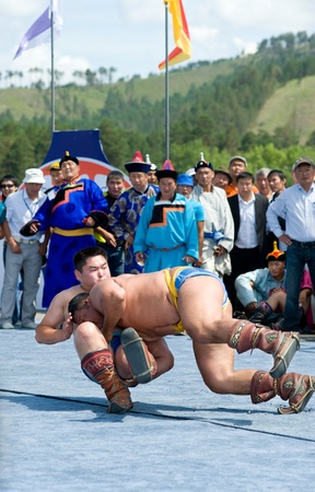 naadan: ULAN-UDE, RUSSIA - JULY 17: The 4th General Session of the World Mongolians Convention, July 17, 2010 in Ulan-Ude, Buryatia, Russia. Mongolian national wrestling in heavyweight. Editorial