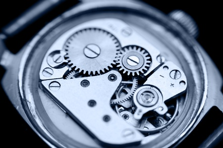 an open mechanical watch, macro, blue toning photo