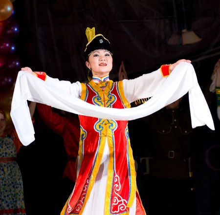ULAN-UDE, RUSSIA - FEBRUARY 10: An unidentified Buryat woman dancer performs a welcome dance at the Annual Republican Best Sportsmen Award, February, 10, 2010, Ulan-Ude, Russia. Stock Photo - 8857529