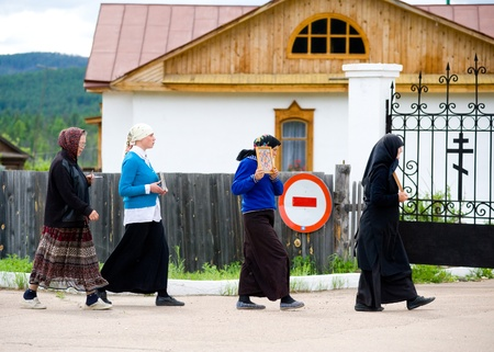 ministration: BATURINO, RUSSIA - JUNE 18: Nuns of the Baturinsky Orthodox Convent end an afternoon icon-bearing procession, June 18, 2010 in Baturino, Buryatia, Russia. Editorial