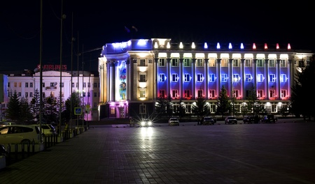 naadan: ULAN-UDE, RUSSIA - JULY 18: The 4th General Session of the World Mongolians Convention, July 18, 2010, Ulan-Ude, Buryatia, Russia. The Parliament building is illuminated with the State flag colours.
