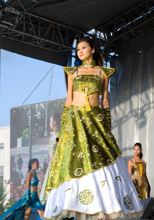 buryatia: ULAN-UDE, RUSSIA - SEPTEMBER 5: A model demonstrates a dress in ethnic style at the fashion show on The City Day celebration, September 5, 2009 in Ulan-Ude, Buryatia, Russia.