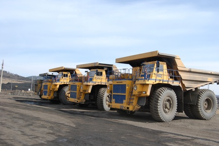 TUGNUI, RUSSIA - APRIL 2: The opening of Tugnuiskaya coal-preparation plant. Giant trucks are ready for coal transportation, April, 2, 2008 in Tugnui, Buryatia, Russia.