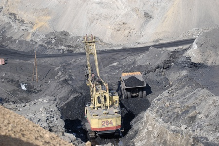 TUGNUI, RUSSIA - APRIL 2: The opening of Tugnuiskaya coal-preparation plant.  A mining shovel puts coal into a hauler, April, 2, 2008 in Tugnui, Buryatia, Russia. Stock Photo - 8971206