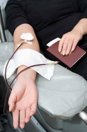 arm of a donor donating blood at hemotransfusion station photo