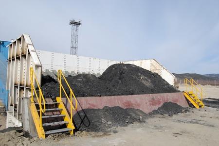 TUGNUI, RUSSIA - APRIL 2: The opening of Tugnuiskaya coal-preparation plant. A place where haulers unload coal, April, 2, 2008 in Tugnui, Buryatia, Russia.