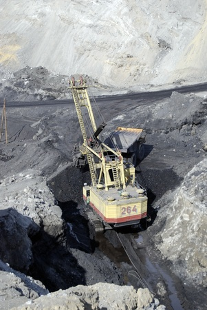 TUGNUI, RUSSIA - APRIL 2: The opening of Tugnuiskaya coal-preparation plant.  A mining shovel puts coal into a hauler, April, 2, 2008 in Tugnui, Buryatia, Russia.