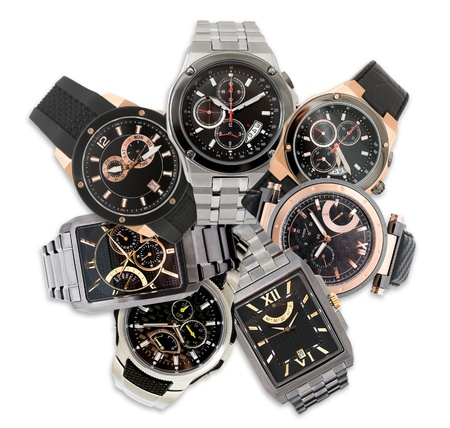 a set of seven different mens watches over white photo