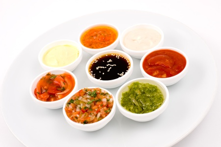 eastern cuisine - several sauceboats with different sauces and seasonings Stock Photo