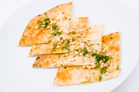 unleavened: lavash, flat unleavened wheat bread, served with pine nuts