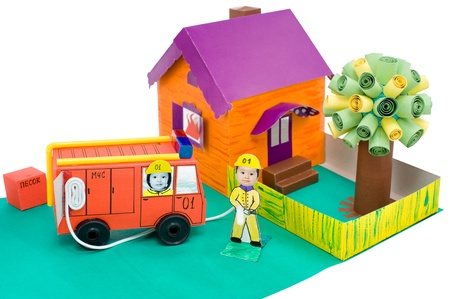 cardboard handicraft - a fire brigade extinguishes the fire in a house, my daughter's work photo