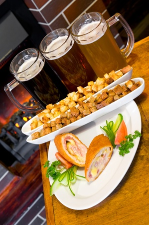 three glasses of different beer with snack photo