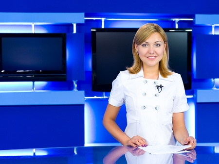 newsreader: a television anchorwoman at studio during live broadcasting Stock Photo